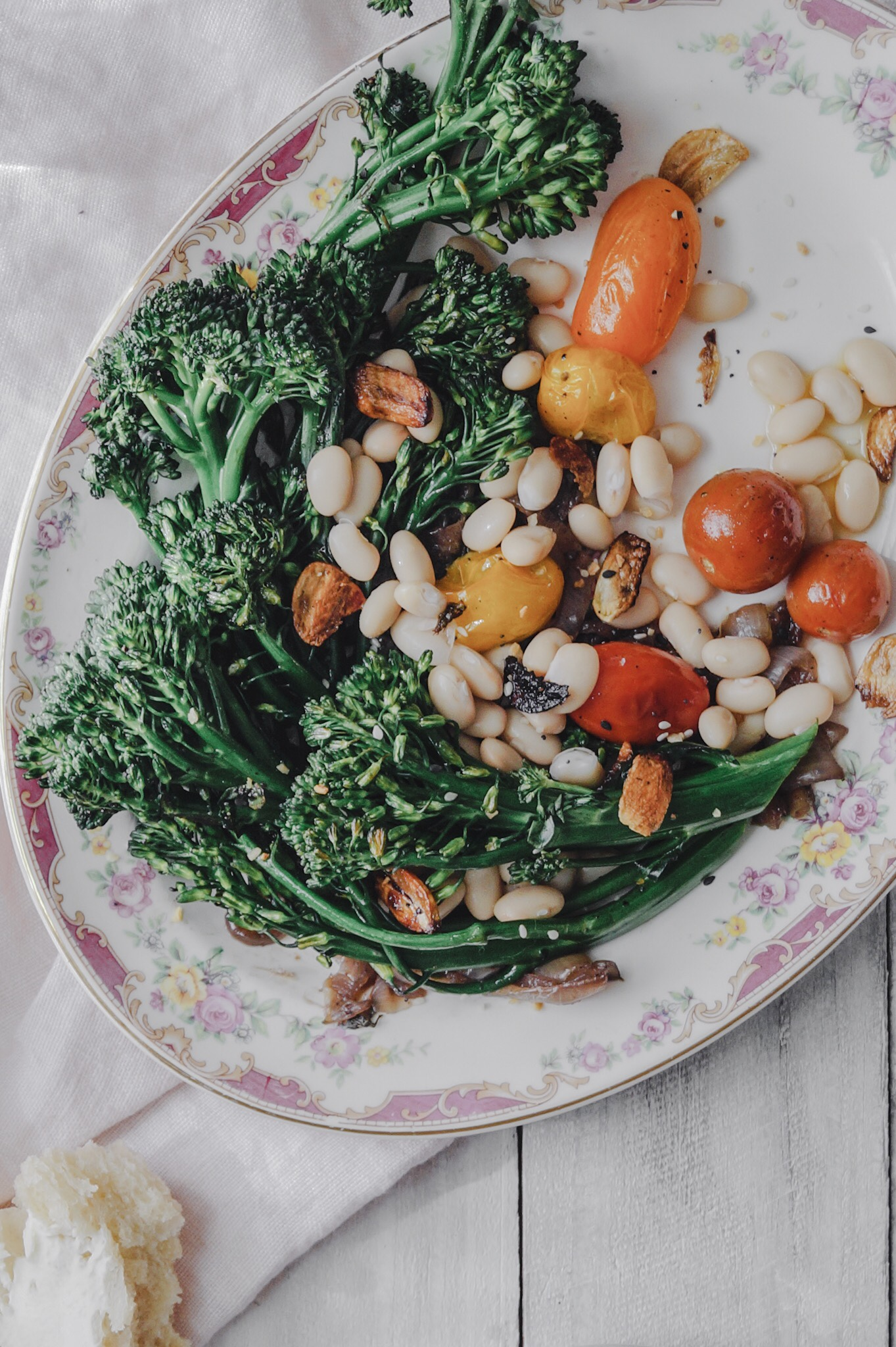 winter salad, healthy easy winter to summer salad recipe with warm beans, roasted tomato, broccoli, and crispy garlic.  Amessybunkitchen.com bright and light food photography, harsh light food photography