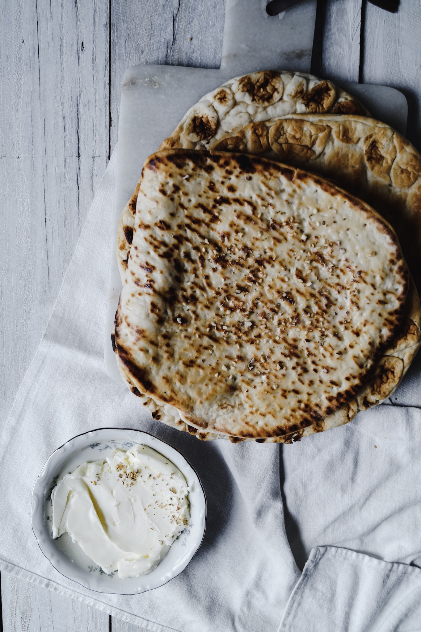 naan bread with melted butter and dukkah spice.