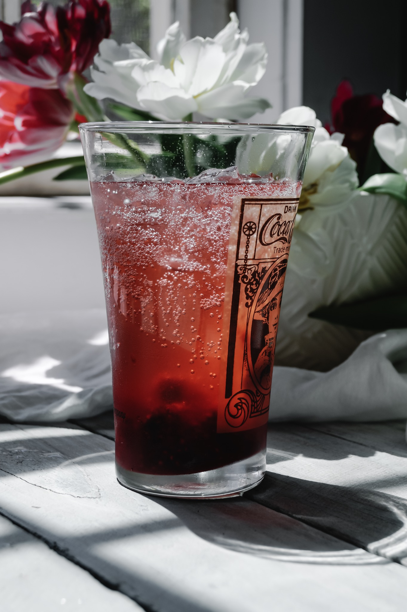 Use a lemony sparkling water to compliment the raspberry syrup.