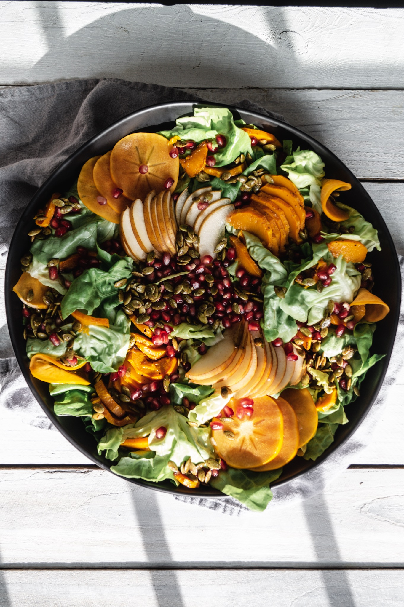 Fall Harvest salad recipe with roasted honeynut squash, pepitas, and pears.