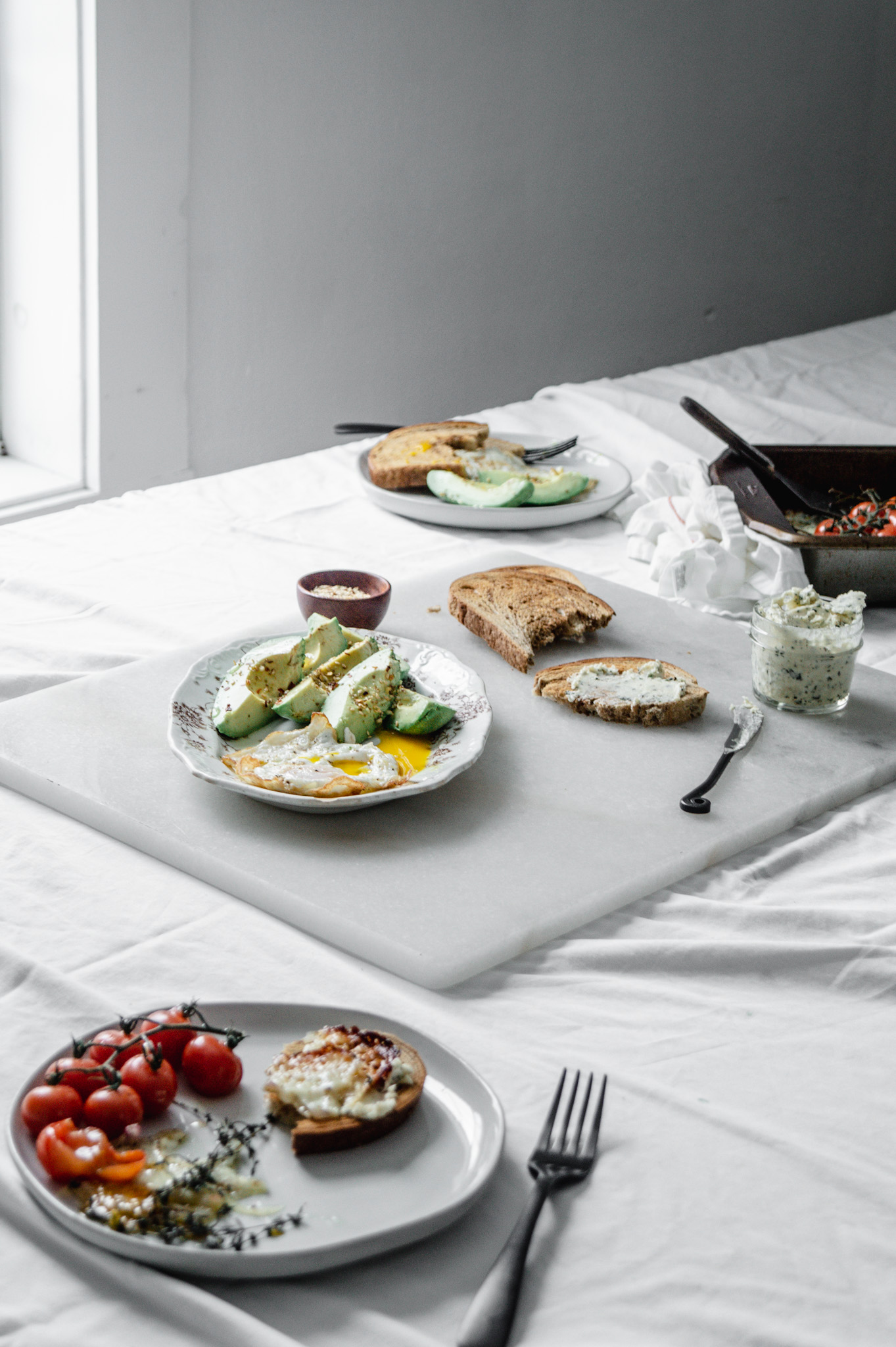 healthy winter brunch ideas: Roasted tomato caprese, seasoned avocados, And fried eggs