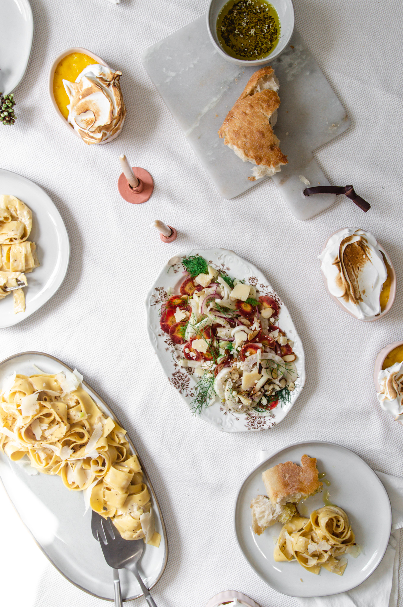 An understated Easter dinner for just our family. Shaved fennel salad. Pasta carbonara and individual orange blossom custards.